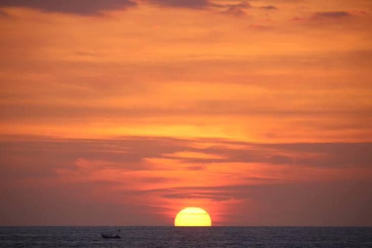 Sunset over the Pacific Ocean at the beachside town of Olón, Ecuador.
