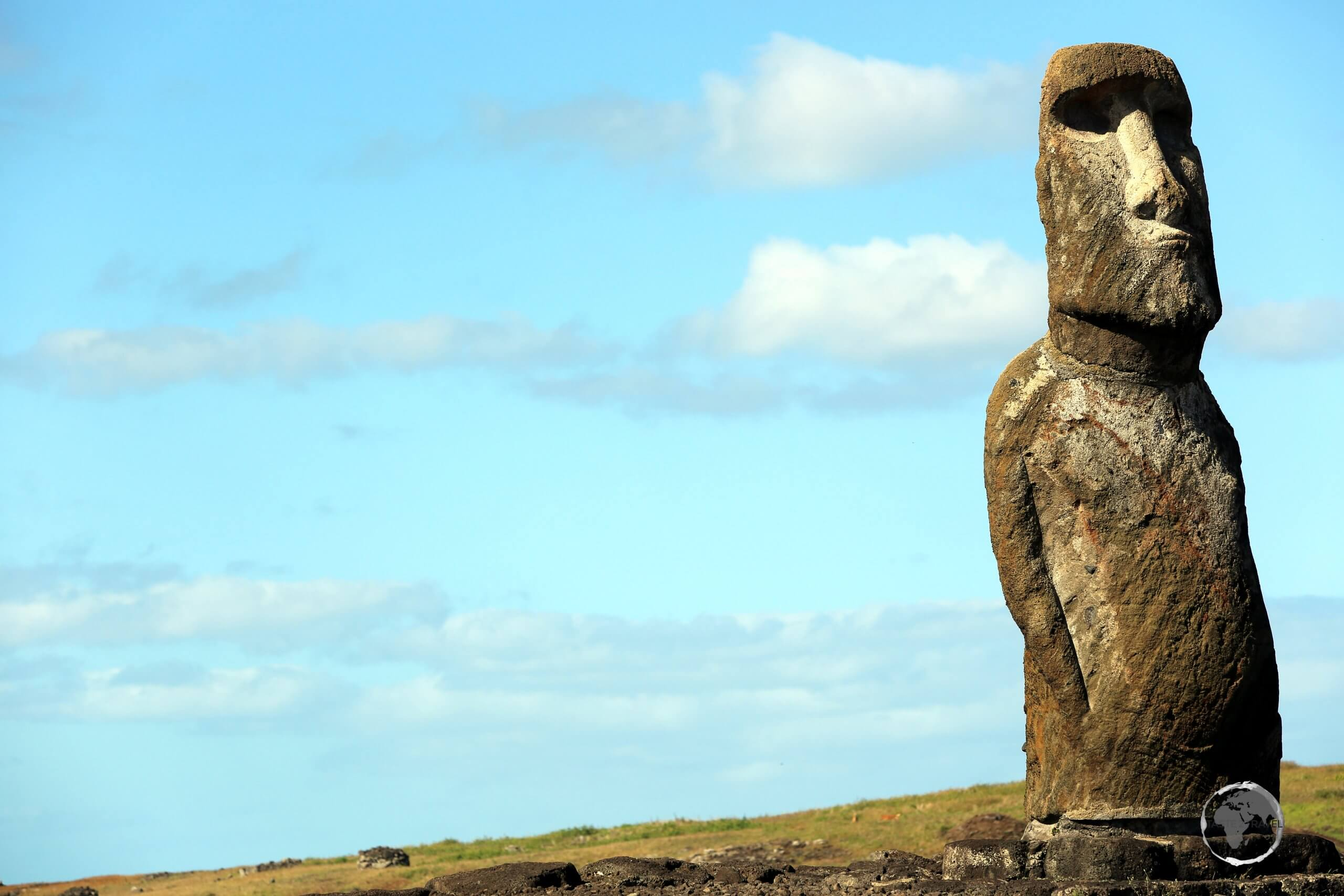 A lone moai, uniquely with arms, stands sentinel over Easter Island.