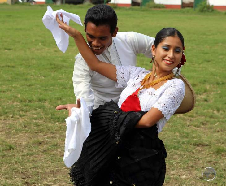 The 'Peruvian Marinera', seen here in Trujillo, is a courtship dance that uses handkerchiefs as props.