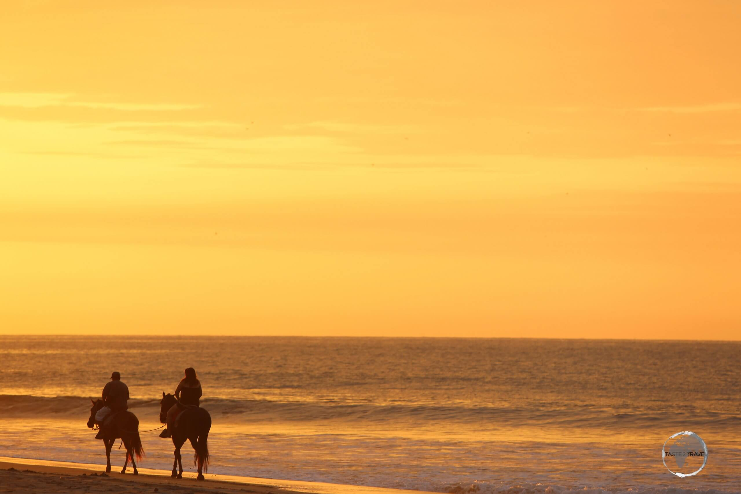 Riding into the sunset at Máncora beach, northern Peru.