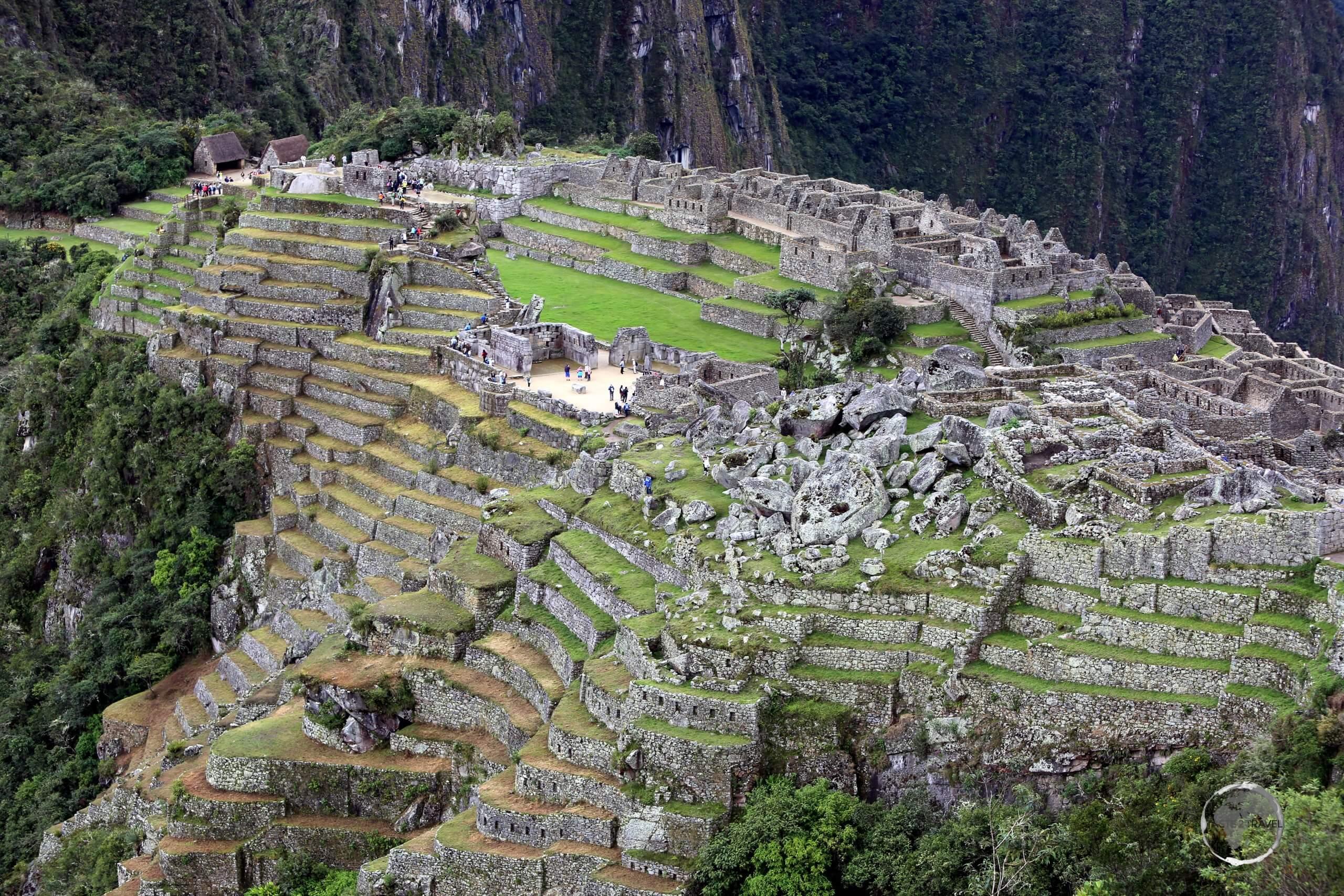 A view of Machu Picchu, a 15th-century Inca citadel, located in the Eastern Cordillera of southern Peru, on a 2,430-metre (7,970 ft) mountain ridge.