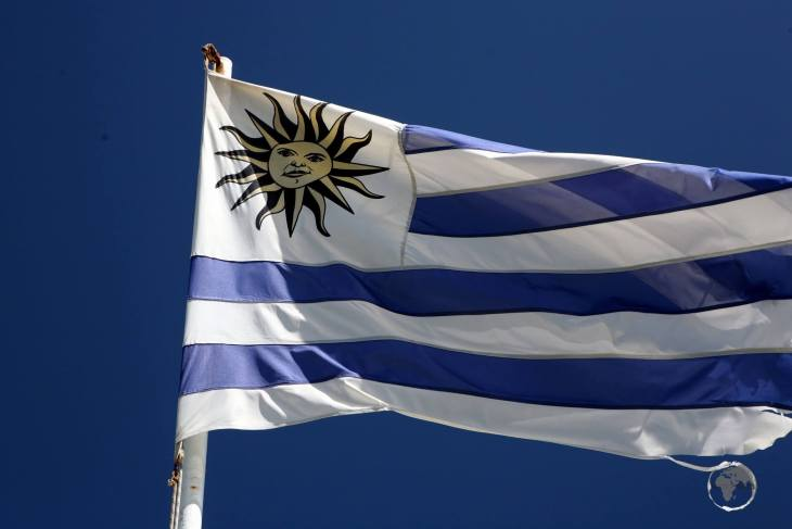 The flag of Uruguay, flying at the Cabo Santa Maria Lighthouse in La Paloma.