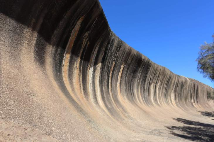 Located in Hyden, Wave Rock is a natural, inland, rock formation that is shaped like a tall breaking ocean wave.