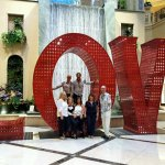 Private food tour posing for a photo at the Love sign inside the lobby of a casino