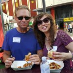 A Couple Eating BBQ Sandwiches on Fremont Street on the Downtown Las Vegas Food Tour