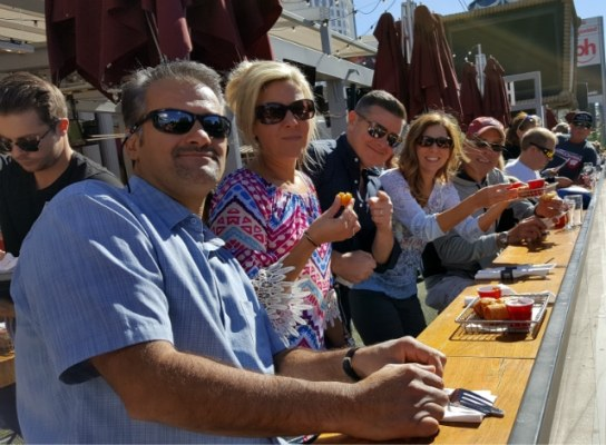 Good friends eating bites of macaroni and cheese egg rolls on the afternoon foodie tour in Las Vegas
