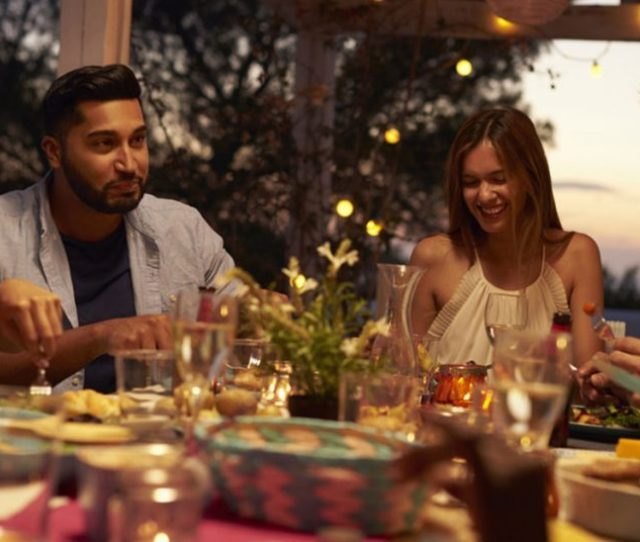 Friends Eat And Talk At A Dinner Party On A Patio Close Up Shutterstock