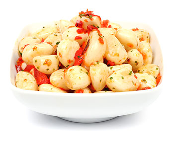 Marinated sweet garlic with peppers and herbs.