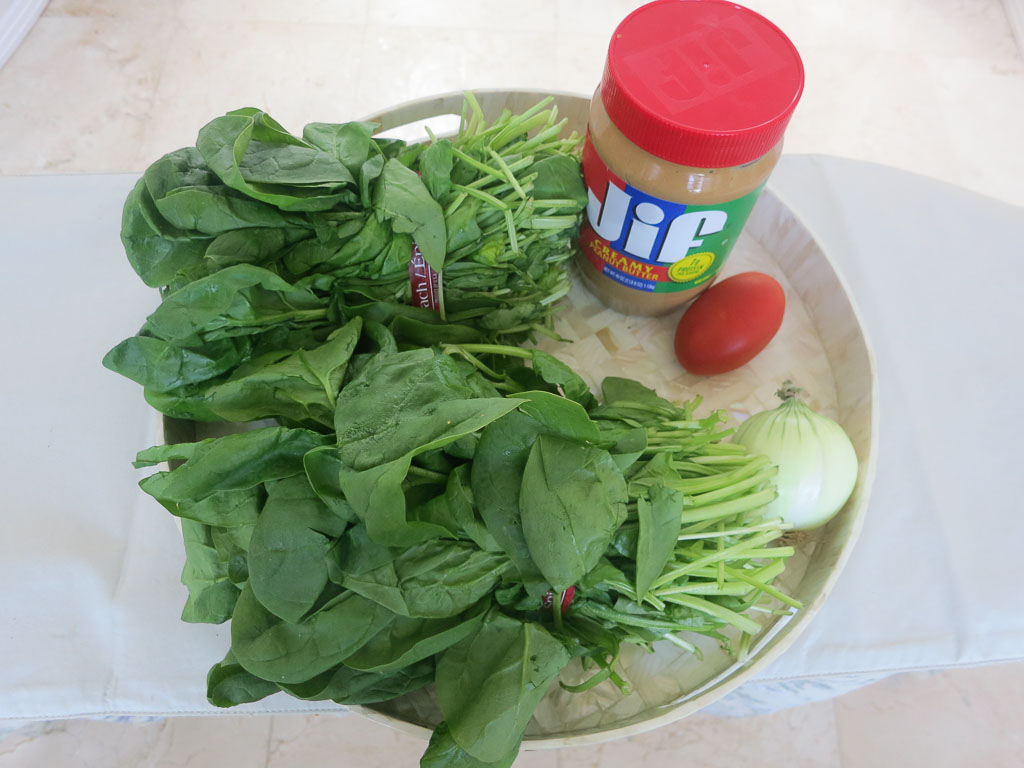 Pictured above are bunched Spinach and ingredients for making spinach with peanut butter