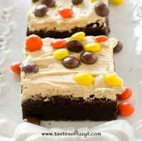 Homemade Reese's Chocolate Peanut Butter Brownies with thick, rich peanut butter frosting and Reese's Pieces. A special treat for chocolate and peanut butter lovers!