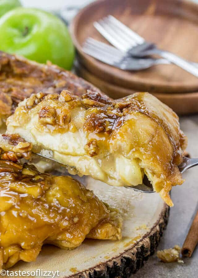 A slice of upside down apple dumpling pie with brown sugar nut syrup