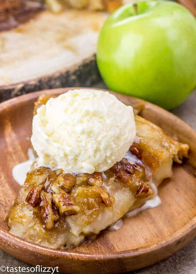 Upside Down Apple Dumpling Pie topped with a scoop of vanilla ice cream