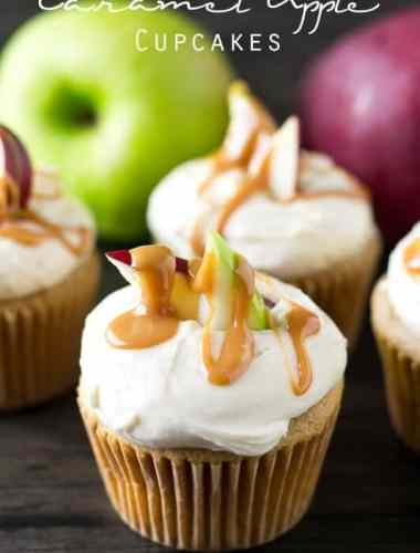 soft cupcakes topped with buttercream frosting, slices of apple and a drizzle of caramel sauce