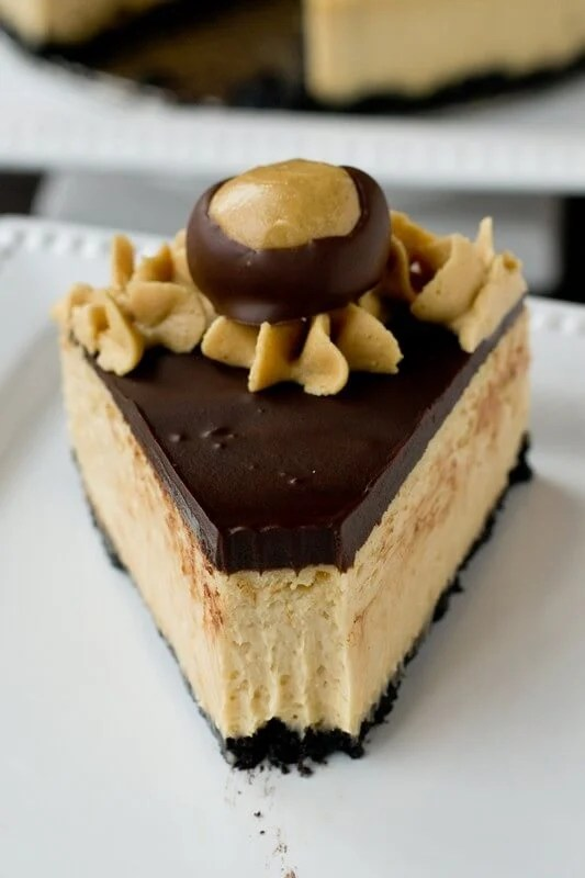 Rich, creamy peanut butter cheesecake topped with sweet chocolate ganache and and an Oreo cookie crust.
