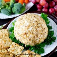 This Garlic Cheese Ball pairs perfectly with Italian herb crackers for a simple, 5 minute appetizer that is full of garlic and Italian cheese flavors.