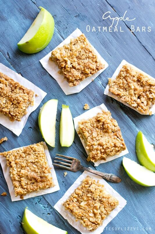 Layered Apple Oatmeal Bars surrounded by fresh green apple slices