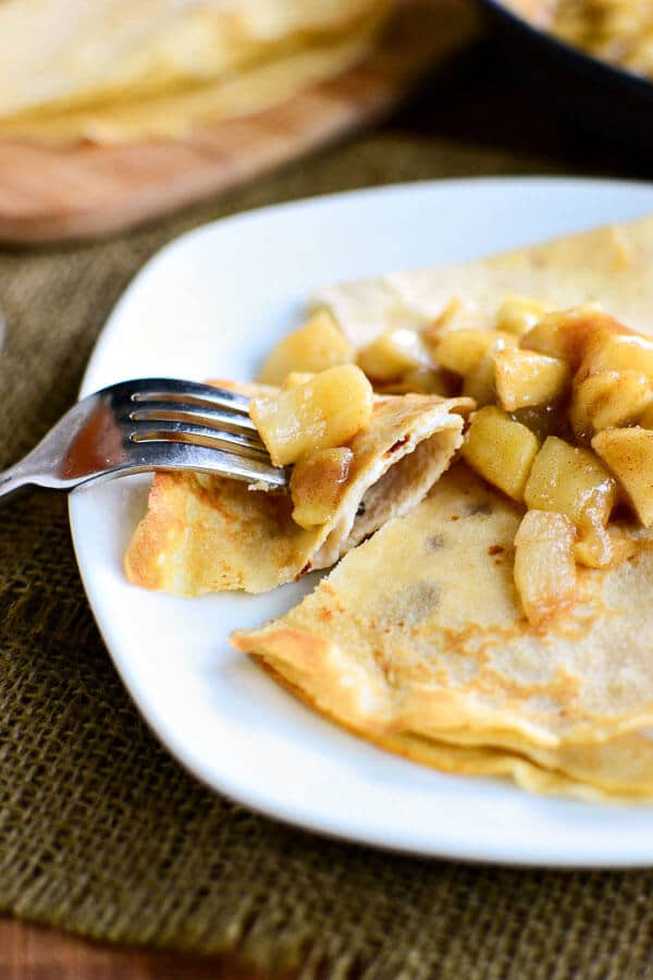 plate of whole wheat apple cider crepes stuffed with vanilla yogurt and topped with apple pie filling