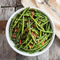 Christmas green beans are dressed up with pimentos and chopped pecans that are caramelized in butter and honey. A simple, healthy side dish to complete your family dinner.