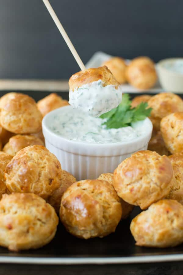 Chipotle Cheddar Gourgeres with Chipotle Lime Dipping Sauce: Crispy gougere puffs flavored with chipotle and cheddar served with a cool cilantro lime dip. A great party appetizer!