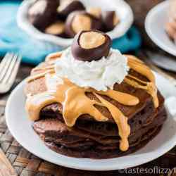 Chocolate Peanut Butter Pancakes {Buckeye Pancakes} Peanut butter buckeye candy filling is cooked inside these fluffy chocolate pancakes. Drizzle with peanut butter and top with whipped cream and a buckeye candy. A perfect Ohio State party recipe!