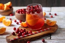 Tart cranberries, juicy tangerines, and tickly bubbles make this Cranberry Tangerine Fizzy drink recipe the BEST holiday drink! Homemade Soda for Christmas parties.