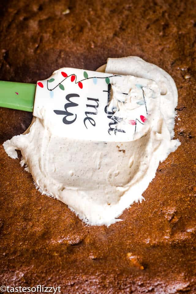 spiced frosting on molasses cake bars