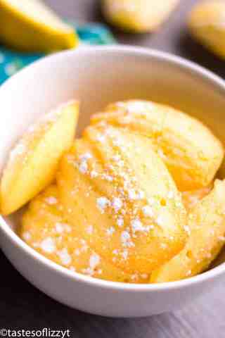 white bowl filled with lemon madeleine cookies