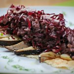 Red-leafed chicory rice on pecorino slab with cardoncelli