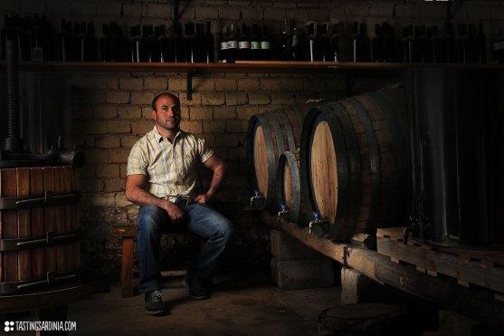 vernaccia wine maker among his barrels