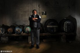 a proud vernaccia wine producer in his own cellar