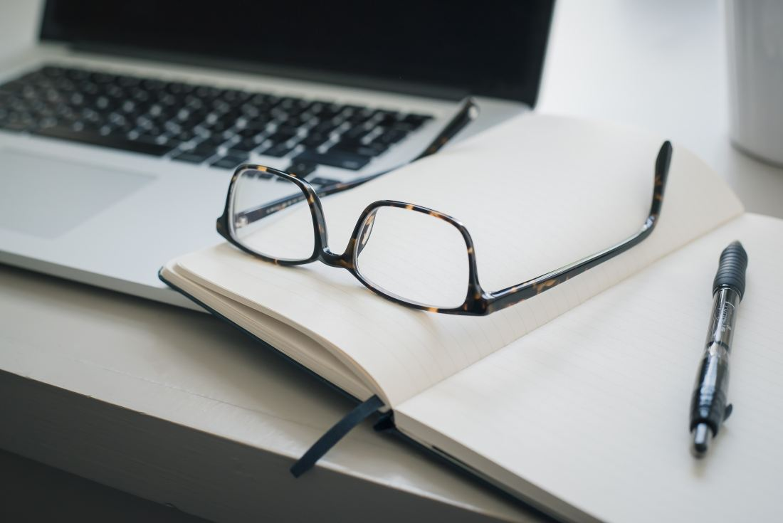 Black glasses with notebook