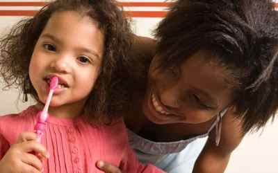 How can I get my toddler to cooperate when I brush her teeth?