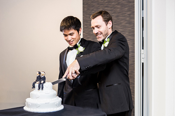 Chris Teoh and Ivan Hinton on their wedding day in Canberra.
