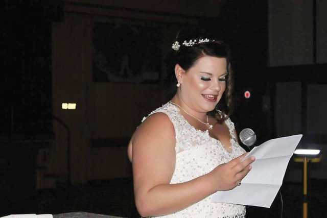 Courtney Smith giving a wedding speech by safety lighting.