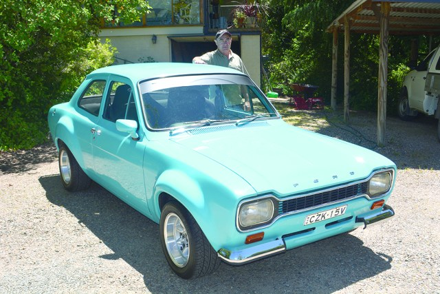 Tumut's Brian Hartshorn with his souped up and flared 1975 Ford Escort.