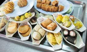 Breakfast in the pork shops starts with a tray of dim sums – you only pay for the ones you eat.