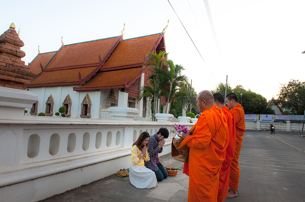 Nan Province Giving alms to monks at Hua Khuang Temple, Nan