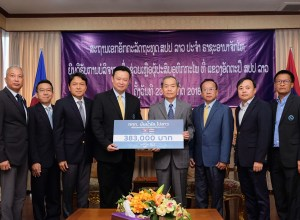 TAT contributes proceeds of charity golf tournament to help flood victims in Lao PDR