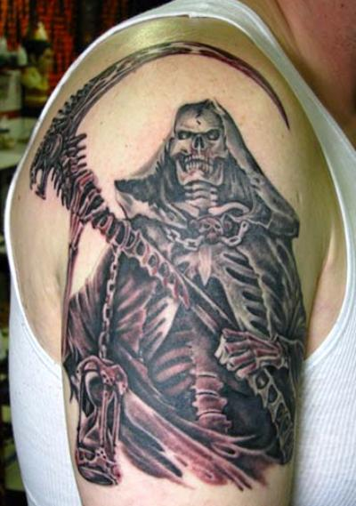 maya tattoos. A scary Grim Reaper with holding long and sharp hacker tattoo