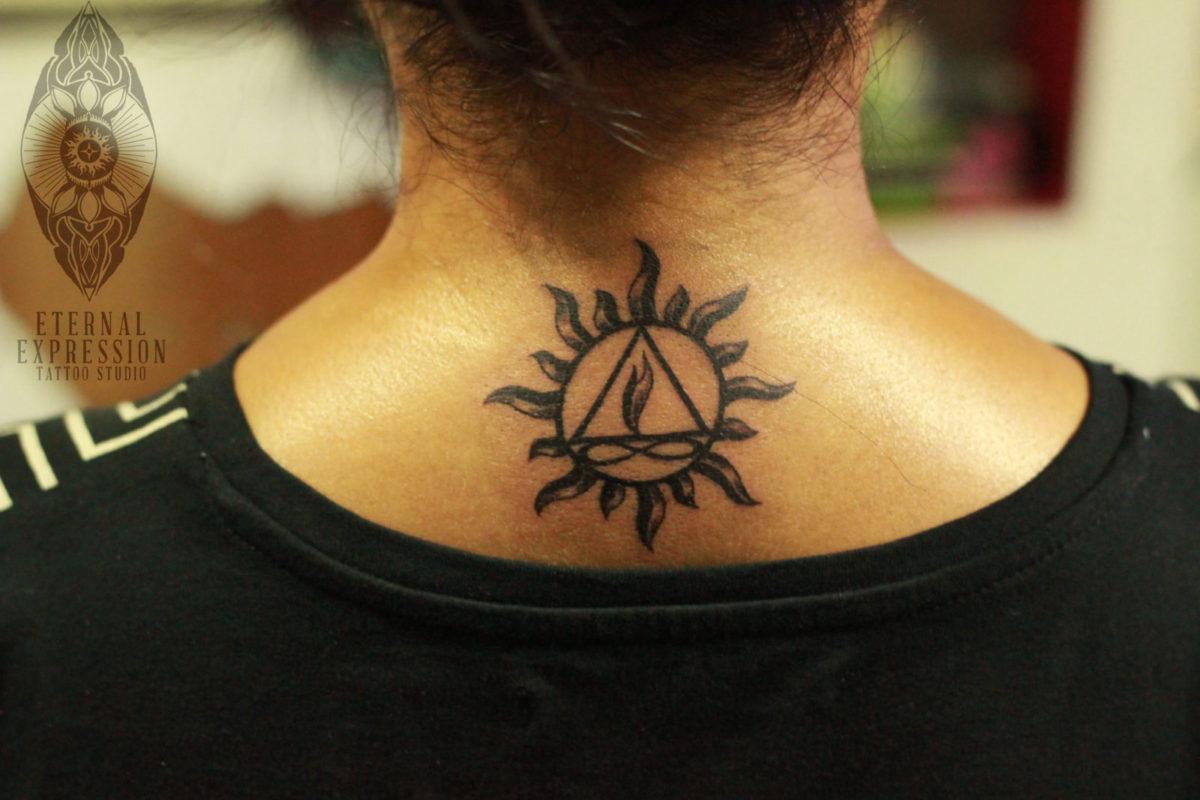 ff6186c67 Sun and Twin flame tattoo - girl gets Tattoo on the nape/back -Tattooed