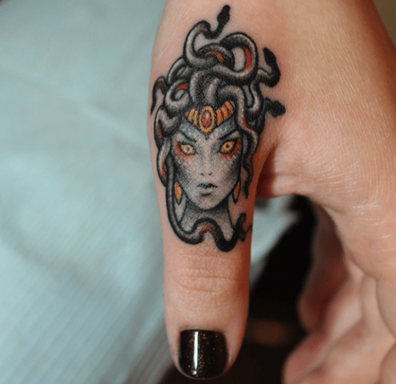 Tattoo on the finger of the girl - Gorgon