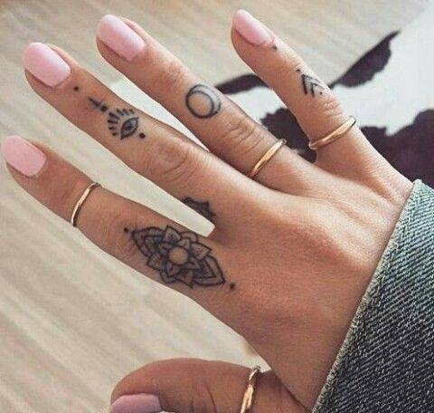 Tattoo ethnic female fingers