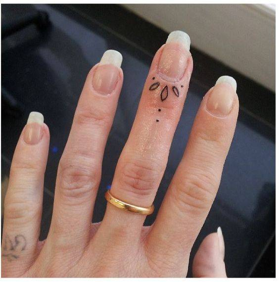 tattoo on a woman's finger