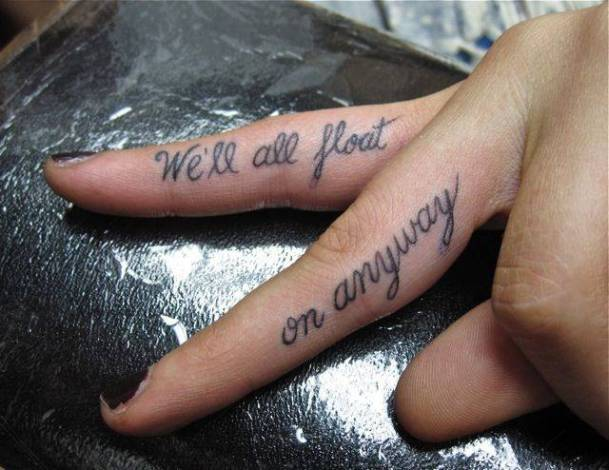 Tattoos on the fingers of the girl - a quote