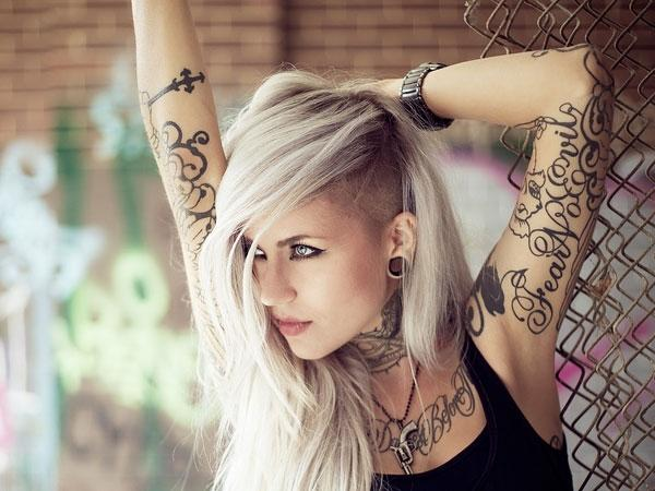 The girl chose a very individual half sleeve tattoo design to express herself