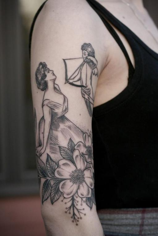An outstandind complex tattoo with a cupid reveals a romantica character of its owner