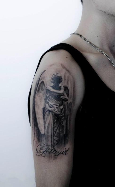 A captivating angel tattoo on the forearm