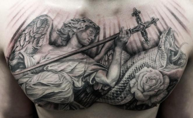 A tremendous tatto with a fighting angel inked on the chest