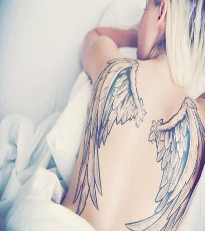 Woman Angel wings tattoo variant on the back