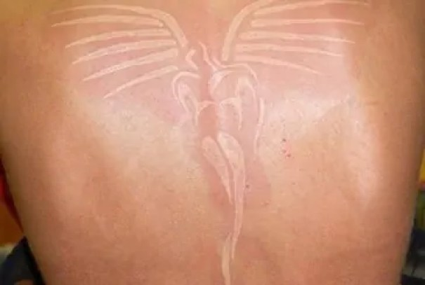 White ink wings tattoo whole back